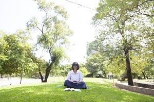 Student homework sitting on the lawn