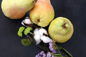 Splendid pears and dry flowers