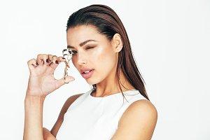 Woman holding a eyelash curler