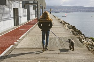 girl walking the dog
