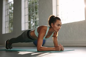 Fit young woman doing push ups