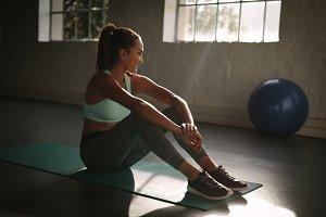 Female at gym taking a break