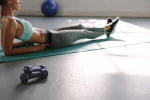 Fitness woman taking rest at gym