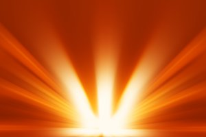Diagonal orange blast of sunlight rays background