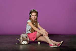 Girl teenager loves to listen to songs.Sporty pretty teen girl loves sports.
