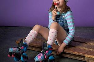 Sporty pretty teen girl loves sports.beautiful little girl eats candy. children's sports fashion.