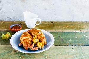 Croissants, jam and fruit