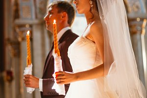 newlyweds wedding ceremony in the church,wedding ceremony, glans