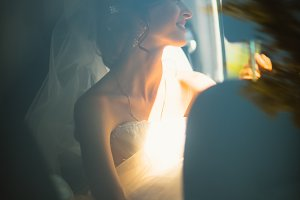 portrait of a young bride in a car window