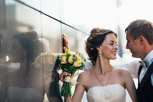 Wedding couple on backround mirror buildings