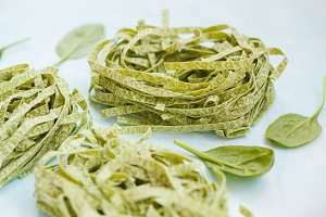 Raw green spinach pasta