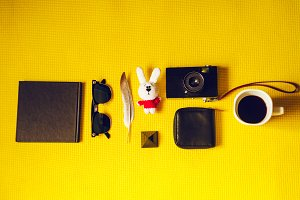 view from above. travel and tourism. camera, notebook, soft toy, coffee, glasses, feather