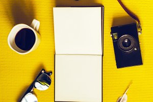 clean notebook for travel planning. accessories, hot coffee
