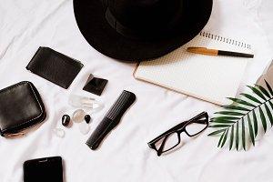 traveler's hat. black objects. notebook