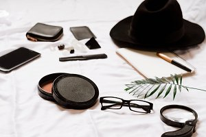 magnifier for the traveler. glasses and hat. phone