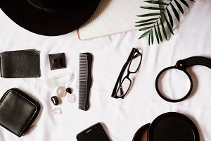 travel and traveler things. purse, hat, comb, stones, phone,