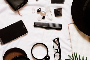 work desk.travel and business. loupe, lacquer, wallet, phone