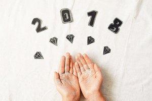 children's hands in sequins. diamonds. new Year