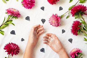 gentle background. pink asters. hands in sequins. diamonds
