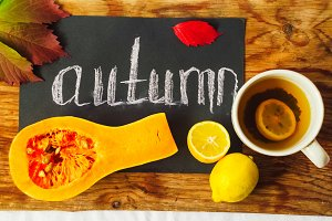 pumpkin and lemons. autumn mood. celebration. hot tea