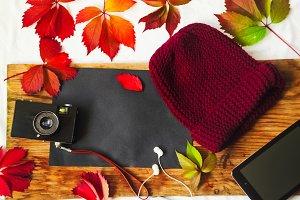 clean sheet of paper. red leaves, hat, tablet, camera, headphones, music,