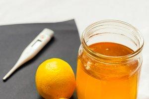 jar of honey. lemon. treatment