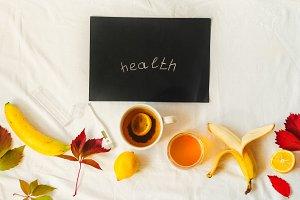 inscription words health. treatment. hot tea, honey, lemon, bananas