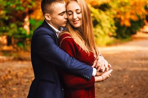 Warm golden autumn. the relationship between a girl and a guy. sincere feelings