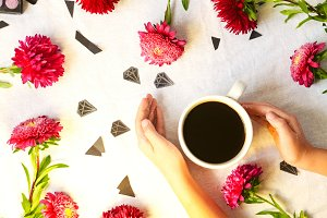 Morning coffee. spring day. flowers and diamonds. sequins. view from above. background and texture