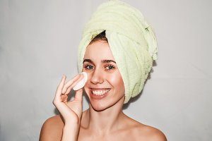portrait of a girl. girl in towel on head, smile on face. youth and beauty.