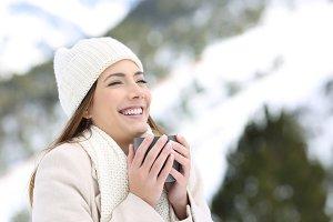 happy woman keeping warm