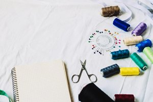 needlework. hobbies and work. sewing workshop. Threads and scissors for work