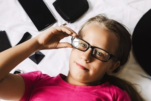 portrait of a girl. glasses for sight. view from above. serious look.