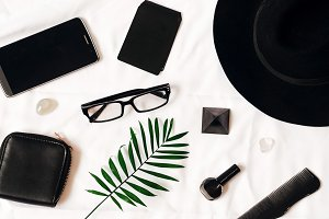 black female style. glasses, phone, business card, wallet, hat. business set