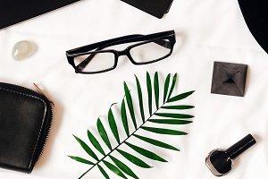 black style.white background. elegant feminine set. black lacquer on the toenails. phone