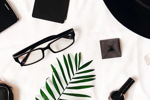 business style. female set. gel nail varnish. black color. White background