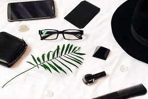black and white stylish combination of objects. business. working space. glasses and a set for travel