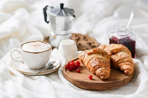 Breakfast in bed with croissants