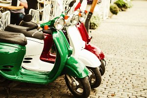 retro scooters. stand on the street. the colors of the flag of Italy