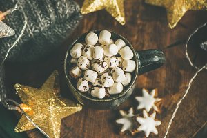Christmas winter hot chocolate with marshmellows over wooden board