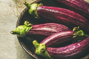 Fresh raw Fall harvest purple eggplants, selective focus
