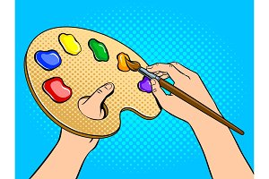 Palette with paints in artist hands pop art vector