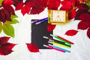 clean sheet of paper. felt pens of different colors and desktop clocks. background and texture