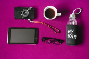 working space. hot strong coffee. camera and tablet. my bottle