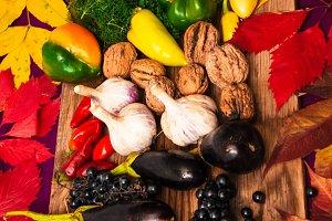 autumn harvest. festive table. eggplants, peppers, garlic, grapes,