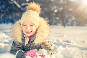 Little girl in a winter park