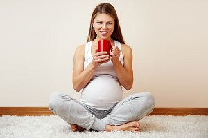 Pregnant woman with tea cup