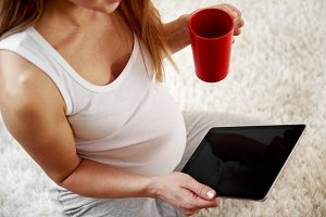 Pregnant woman with tablet pc