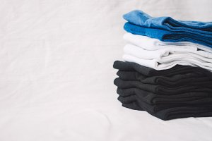 the fabric lies folded in a pile. colors: black, blue, white. texture and background