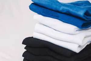 texture of tissues. the fabrics lie in a pile. colors black, white, blue